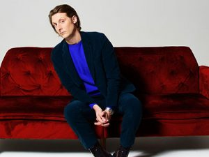 Eric-Hutchinson-red-couch